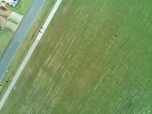 An image captured from our UAV flying, with a shirt laid out for us to identify